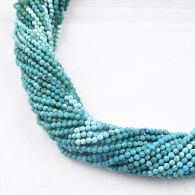 tiny turquoise faceted beads